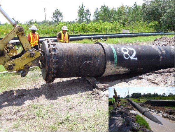 Трубопроводы большого диаметра монтируются с использованием спецтехники.